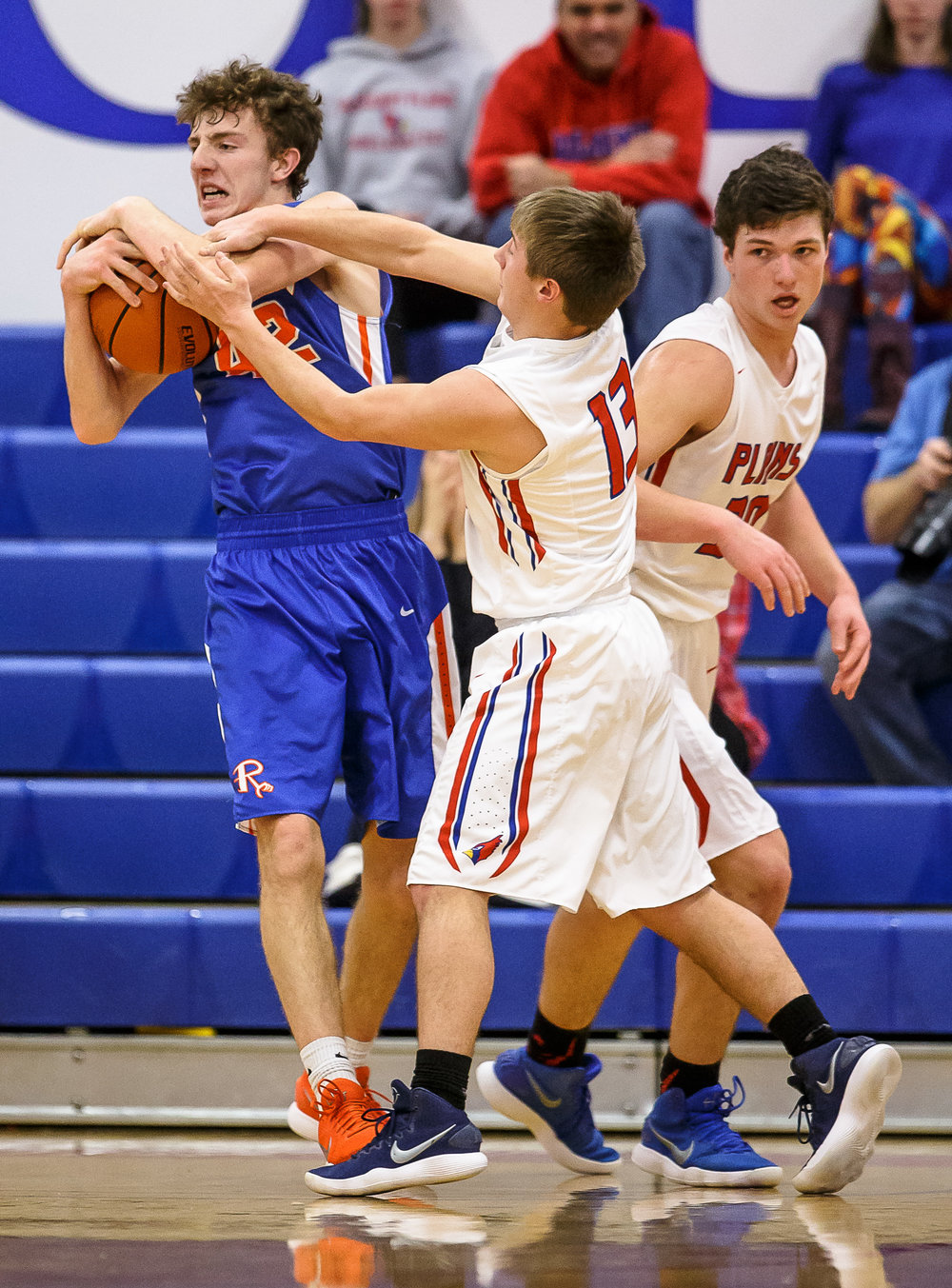 Riverton's Spencer Yoggerst (42) comes down with a rebound against Pleasant Plains' Kevin Ingram (13) in the first half during the second night of the Boys Sangamon County Tournament at Lincoln Land Community College's Cass Gymnasium, Tuesday, Jan. 9, 2018, in Springfield, Ill. [Justin L. Fowler/The State Journal-Register]