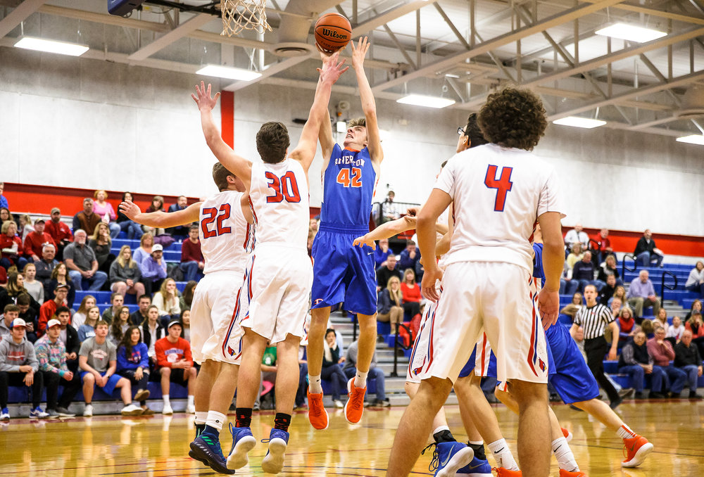 Riverton's Spencer Yoggerst (42) goes up for a basket against Pleasant Plains' Joel Niermann (30) in the first half during the second night of the Boys Sangamon County Tournament at Lincoln Land Community College's Cass Gymnasium, Tuesday, Jan. 9, 2018, in Springfield, Ill. [Justin L. Fowler/The State Journal-Register]