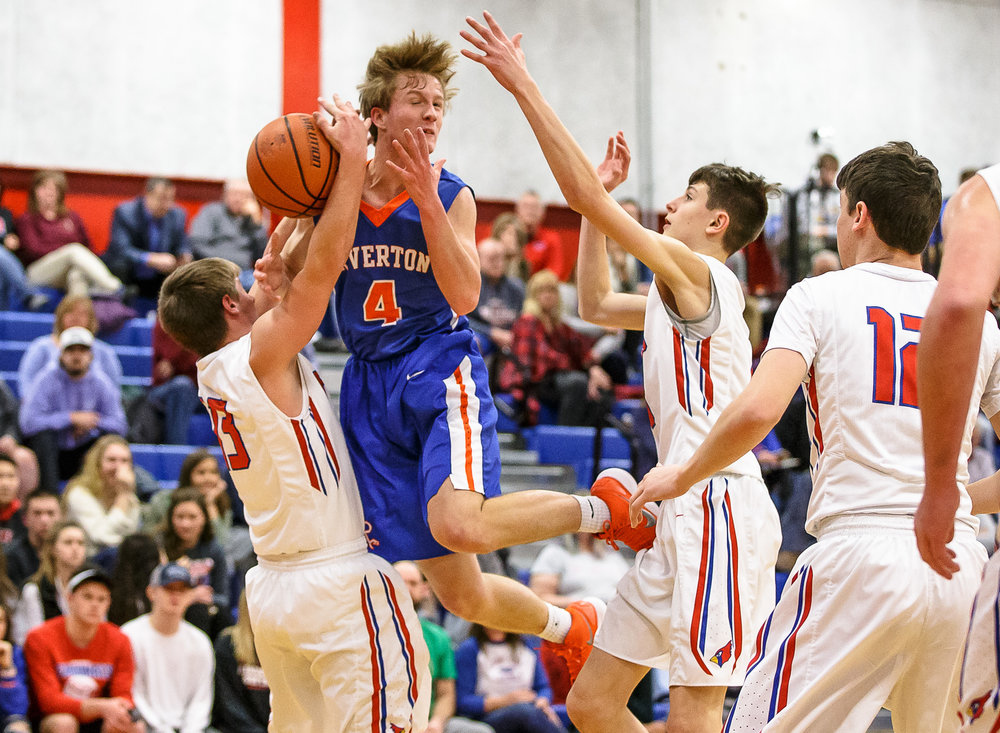 Riverton's Colton Charles (4) gets fouled by Pleasant Plains' Kevin Ingram (13) as he drives up to the basket in the first half during the second night of the Boys Sangamon County Tournament at Lincoln Land Community College's Cass Gymnasium, Tuesday, Jan. 9, 2018, in Springfield, Ill. [Justin L. Fowler/The State Journal-Register]