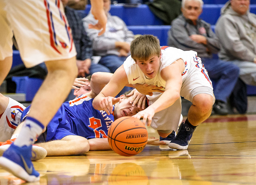 Pleasant Plains' Kevin Ingram (13) goes after the ball as he hits the floor with Riverton's Spencer Yoggerst (42) in the first half during the second night of the Boys Sangamon County Tournament at Lincoln Land Community College's Cass Gymnasium, Tuesday, Jan. 9, 2018, in Springfield, Ill. [Justin L. Fowler/The State Journal-Register]