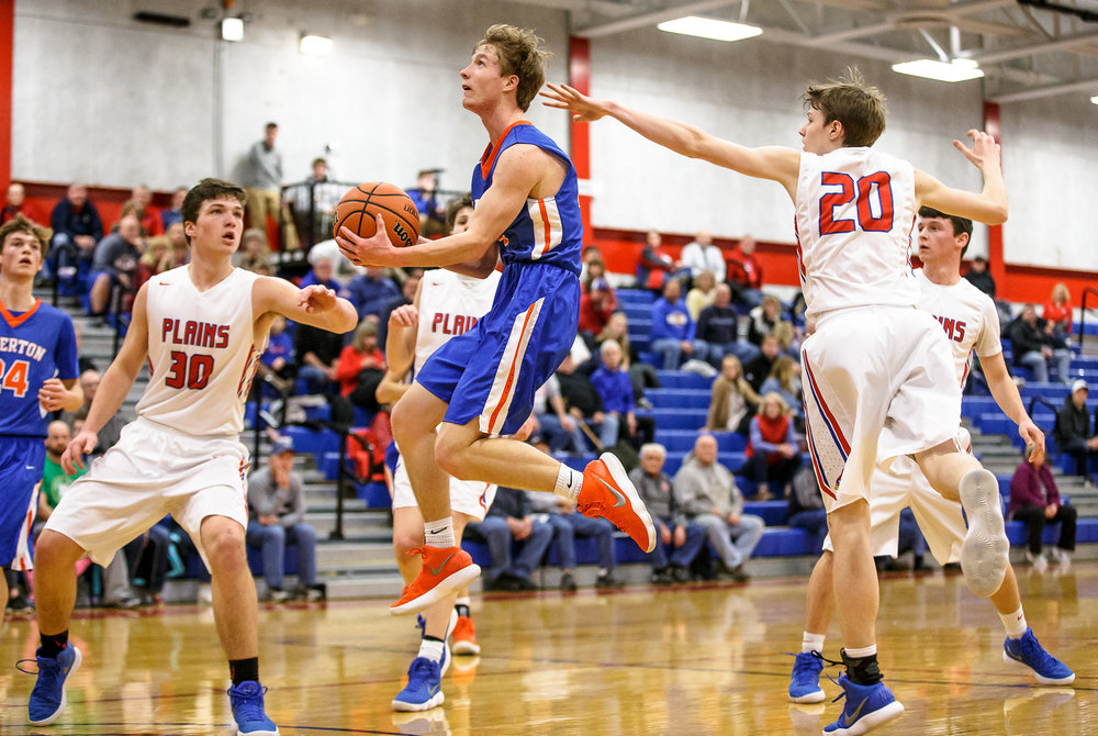 Riverton's Colton Charles (4) streaks past Pleasant Plains' Nick Savage (20) as he goes up for the lay-in against Pleasant Plains' Joel Niermann (30) in the first half during the second night of the Boys Sangamon County Tournament at Lincoln Land Community College's Cass Gymnasium, Tuesday, Jan. 9, 2018, in Springfield, Ill. [Justin L. Fowler/The State Journal-Register]