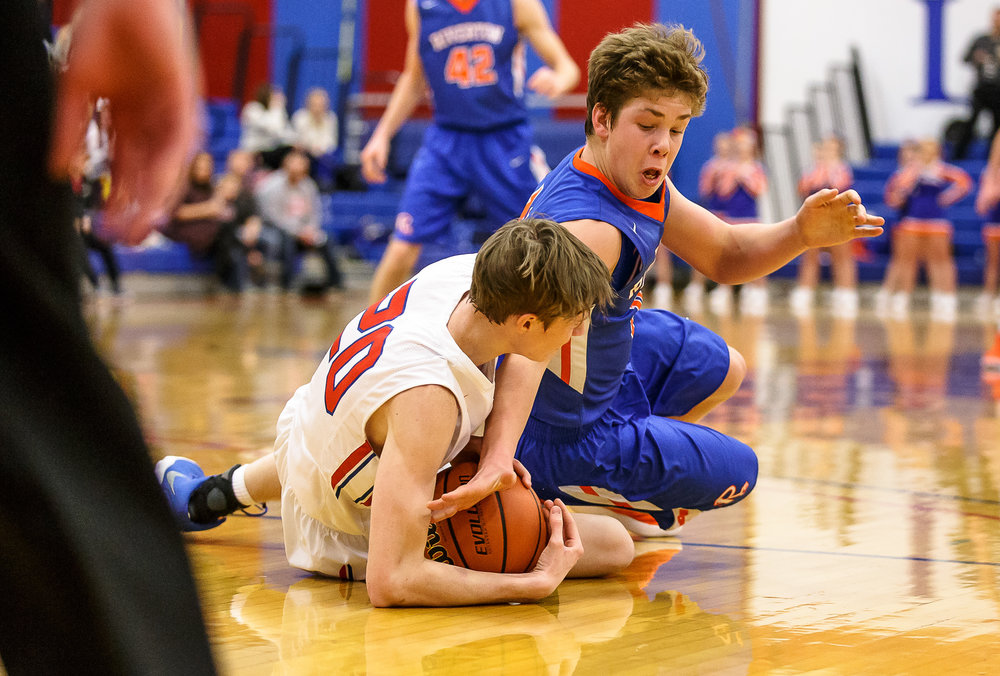 Riverton's Tyler Moushon (14) hist the floor going after a ball against Pleasant Plains' Nick Savage (20) in the first half during the second night of the Boys Sangamon County Tournament at Lincoln Land Community College's Cass Gymnasium, Tuesday, Jan. 9, 2018, in Springfield, Ill. [Justin L. Fowler/The State Journal-Register]
