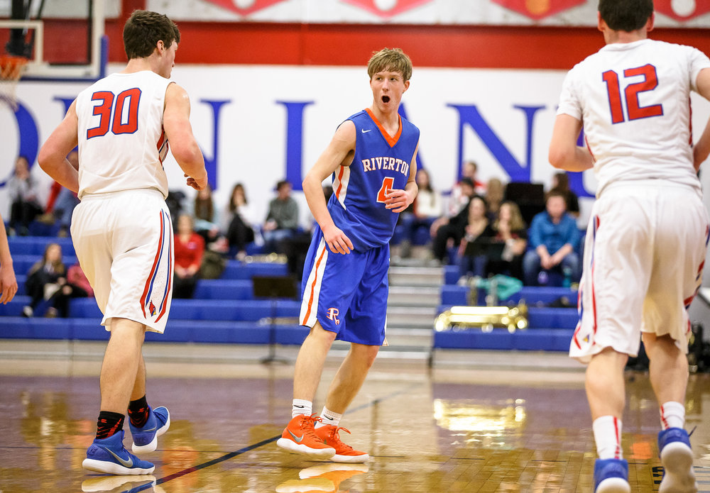 Riverton's Colton Charles (4) celebrates after hitting a 3-pointer against Pleasant Plains in the first half during the second night of the Boys Sangamon County Tournament at Lincoln Land Community College's Cass Gymnasium, Tuesday, Jan. 9, 2018, in Springfield, Ill. [Justin L. Fowler/The State Journal-Register]