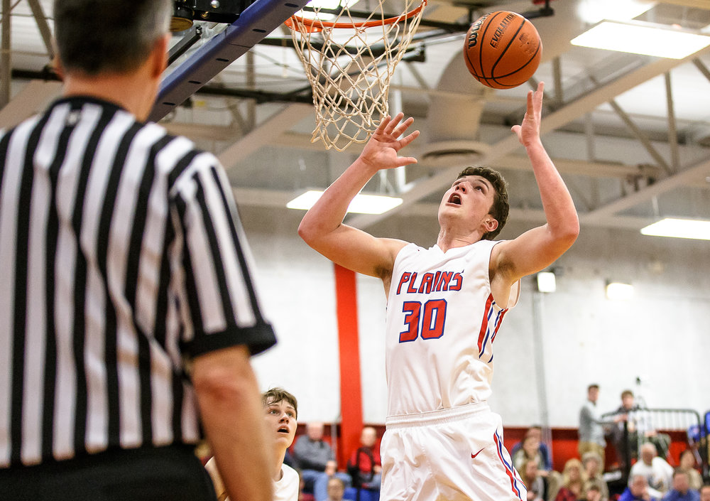 Pleasant Plains' Joel Niermann (30) goes up for a rebound against Riverton in the first half during the second night of the Boys Sangamon County Tournament at Lincoln Land Community College's Cass Gymnasium, Tuesday, Jan. 9, 2018, in Springfield, Ill. [Justin L. Fowler/The State Journal-Register]