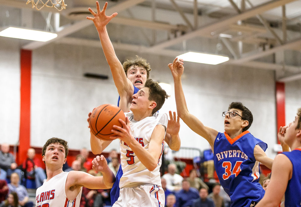 Pleasant Plains' Justin Guernsey (5) draws the foul from behind against Riverton's Travis Hogan (34) as he goes up to the basket in the second half during the second night of the Boys Sangamon County Tournament at Lincoln Land Community College's Cass Gymnasium, Tuesday, Jan. 9, 2018, in Springfield, Ill. [Justin L. Fowler/The State Journal-Register]