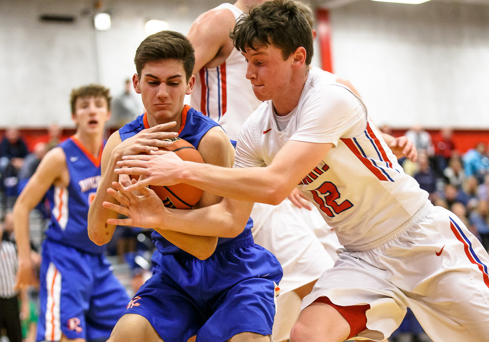 Pleasant Plains' TJ Painter (12) tries to steal a rebound away from Riverton's Griffin King (12) in the second half during the second night of the Boys Sangamon County Tournament at Lincoln Land Community College's Cass Gymnasium, Tuesday, Jan. 9, 2018, in Springfield, Ill. [Justin L. Fowler/The State Journal-Register]