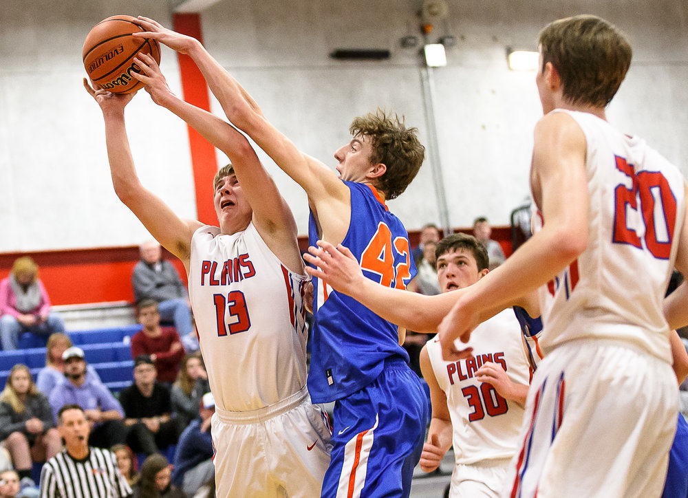 Riverton's Spencer Yoggerst (42) blocks a shot from Pleasant Plains' Kevin Ingram (13) in the second half during the second night of the Boys Sangamon County Tournament at Lincoln Land Community College's Cass Gymnasium, Tuesday, Jan. 9, 2018, in Springfield, Ill. [Justin L. Fowler/The State Journal-Register]