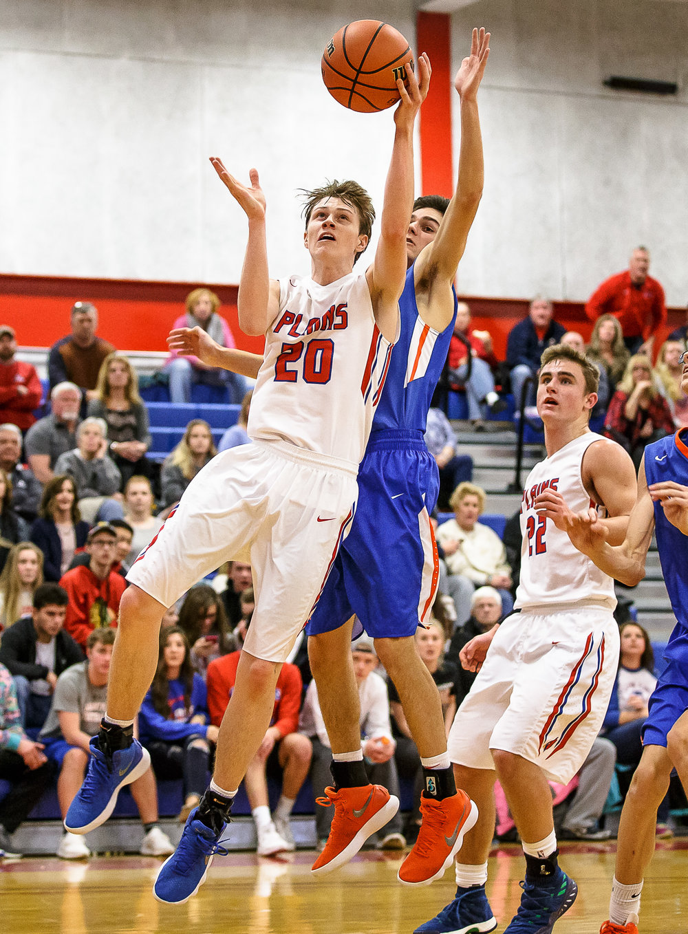 Pleasant Plains' Nick Savage (20) goes up for a lay-in against Riverton's Griffin King (12) in the second half during the second night of the Boys Sangamon County Tournament at Lincoln Land Community College's Cass Gymnasium, Tuesday, Jan. 9, 2018, in Springfield, Ill. [Justin L. Fowler/The State Journal-Register]