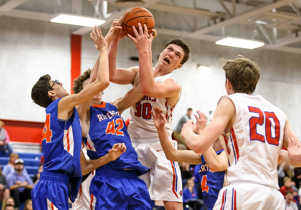 Pleasant Plains' Joel Niermann (30) comes down with a rebound against Riverton's Spencer Yoggerst (42) in the second half during the second night of the Boys Sangamon County Tournament at Lincoln Land Community College's Cass Gymnasium, Tuesday, Jan. 9, 2018, in Springfield, Ill. [Justin L. Fowler/The State Journal-Register]