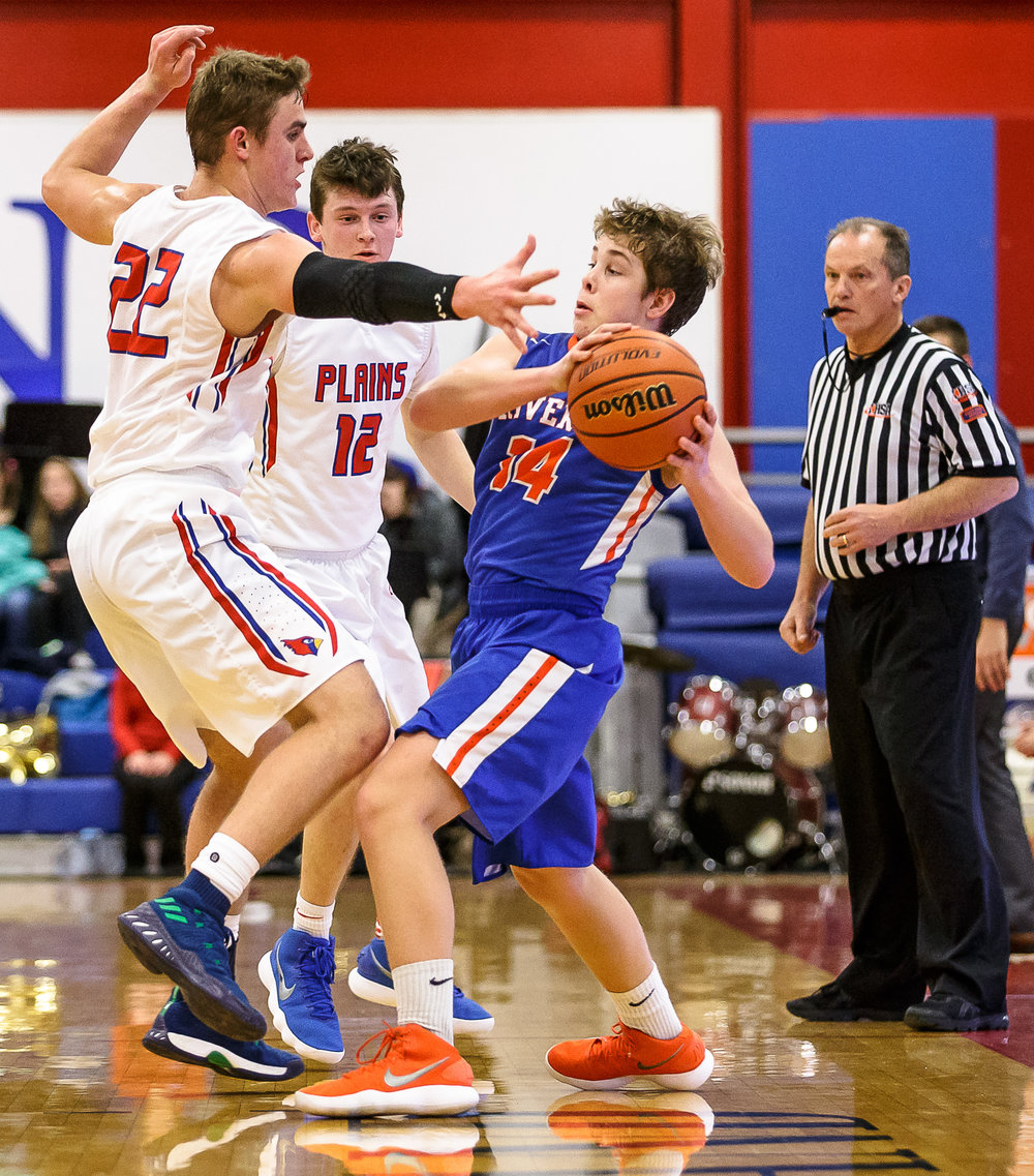 Riverton's Tyler Moushon (14) is pressured by Pleasant Plains' Tristen Tewes (22) in the second half during the second night of the Boys Sangamon County Tournament at Lincoln Land Community College's Cass Gymnasium, Tuesday, Jan. 9, 2018, in Springfield, Ill. [Justin L. Fowler/The State Journal-Register]