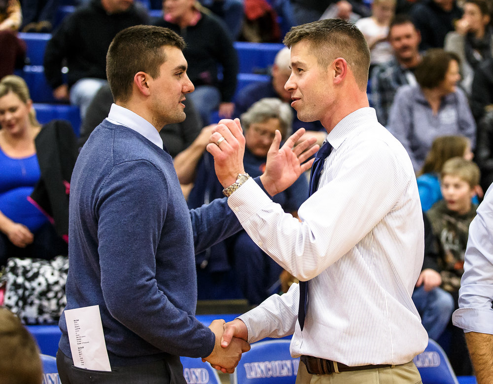 Riverton boys basketball head coach Kody Kirkpatrick, left, shakes hands with Pleasant Plains boys basketball head coach Kyle Weber after Riverton defeated Pleasant Plains 47-39 during the second night of the Boys Sangamon County Tournament at Lincoln Land Community College's Cass Gymnasium, Tuesday, Jan. 9, 2018, in Springfield, Ill. [Justin L. Fowler/The State Journal-Register]