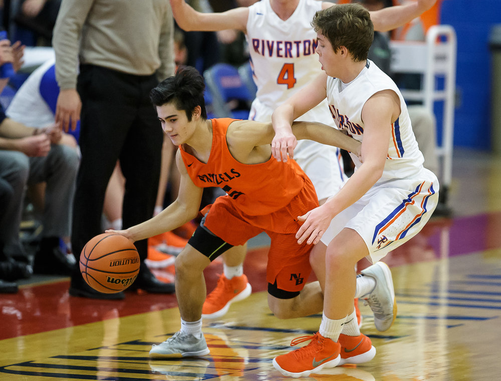 New Berlin's Christian Knox (5) is pressured by Riverton's Tyler Moushon (14) as he tries to dribble around him in the first half during the semifinals of the Boys Sangamon County Tournament at Lincoln Land Community College's Cass Gymnasium, Wednesday, Jan. 10, 2018, in Springfield, Ill. [Justin L. Fowler/The State Journal-Register]