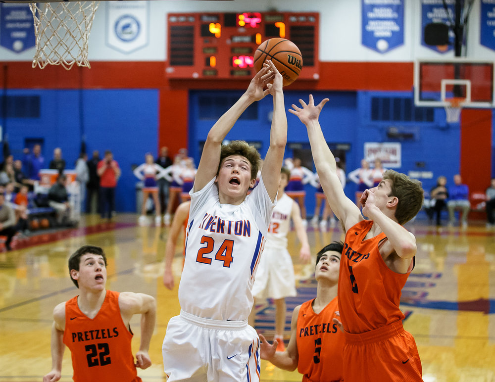 Riverton's Colton Heckman (24) goes for a rebound against New Berlin's Kyle Diamond (2) in the first half during the semifinals of the Boys Sangamon County Tournament at Lincoln Land Community College's Cass Gymnasium, Wednesday, Jan. 10, 2018, in Springfield, Ill. [Justin L. Fowler/The State Journal-Register]