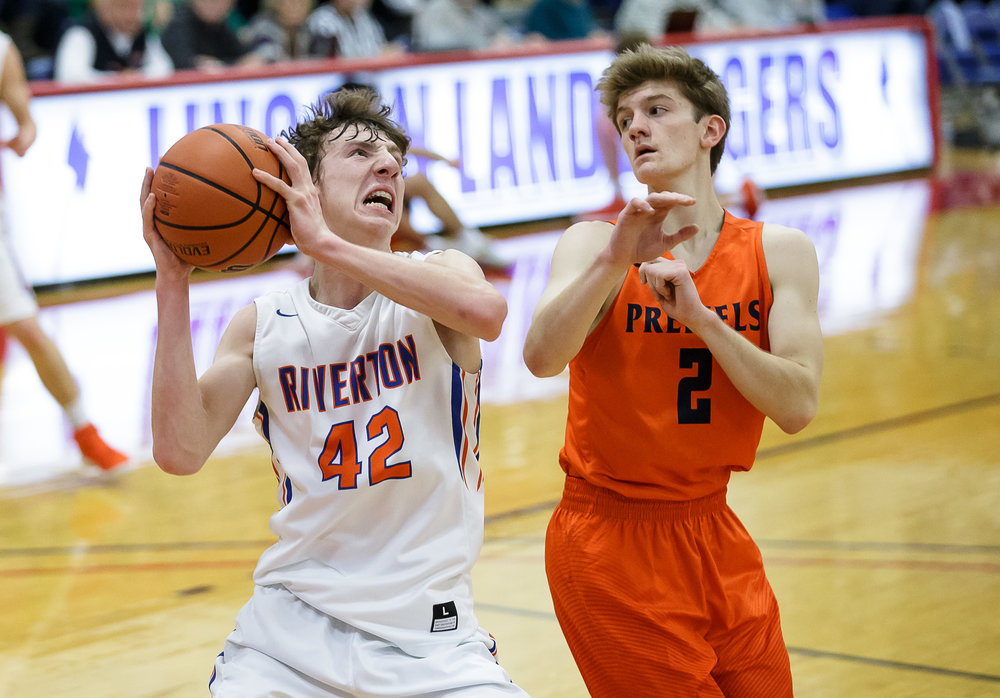 Riverton's Spencer Yoggerst (42) pulls in a rebound against New Berlin's Kyle Diamond (2) in the first half during the semifinals of the Boys Sangamon County Tournament at Lincoln Land Community College's Cass Gymnasium, Wednesday, Jan. 10, 2018, in Springfield, Ill. [Justin L. Fowler/The State Journal-Register]