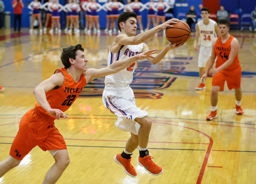 Riverton's Griffin King (12) comes down with a rebound against New Berlin's Connor Allen (22) in the first half during the semifinals of the Boys Sangamon County Tournament at Lincoln Land Community College's Cass Gymnasium, Wednesday, Jan. 10, 2018, in Springfield, Ill. [Justin L. Fowler/The State Journal-Register]