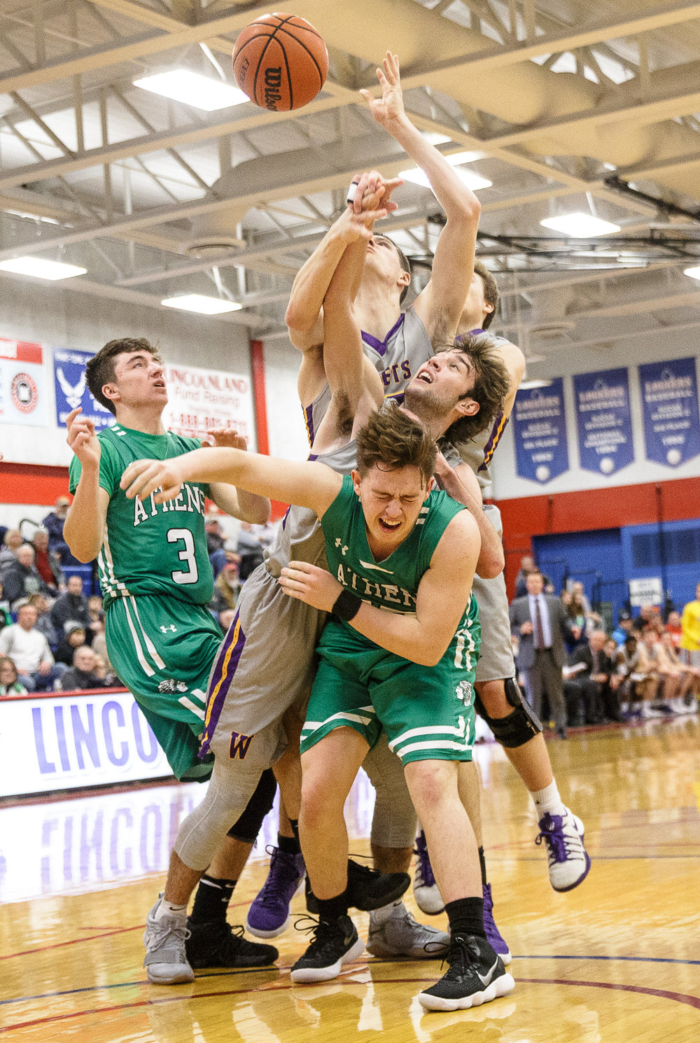 Athens' Nic Laird (13) collides with Williamsville's Joseph Mitchell (13) as they go for a rebound underneath the basket in the first half during the semifinals of the Boys Sangamon County Tournament at Lincoln Land Community College's Cass Gymnasium, Wednesday, Jan. 10, 2018, in Springfield, Ill. [Justin L. Fowler/The State Journal-Register]