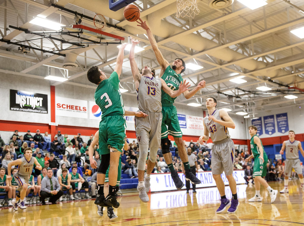 Athens' Garrett Reichert (21) blocks a shot from Williamsville's Joseph Mitchell (13) in the first half during the semifinals of the Boys Sangamon County Tournament at Lincoln Land Community College's Cass Gymnasium, Wednesday, Jan. 10, 2018, in Springfield, Ill. [Justin L. Fowler/The State Journal-Register]