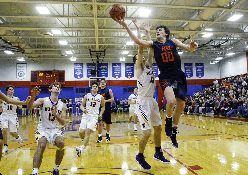New Berlin's Max Day slips two past Williamsville's Scott O'Conner during the championship game of the Sangamon County Tournament Friday at Lincoln Land Community College, Jan. 12, 2018. [Ted Schurter/The State Journal-Register]