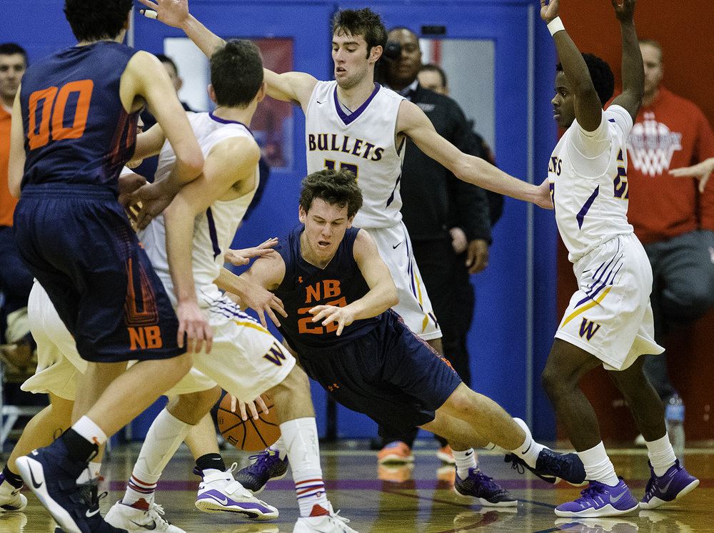 New Berlin's Connor Allen crashes to the ground after getting trapped by the Williamsville's defense during the championship game of the Sangamon County Tournament Friday at Lincoln Land Community College, Jan. 12, 2018. [Ted Schurter/The State Journal-Register]