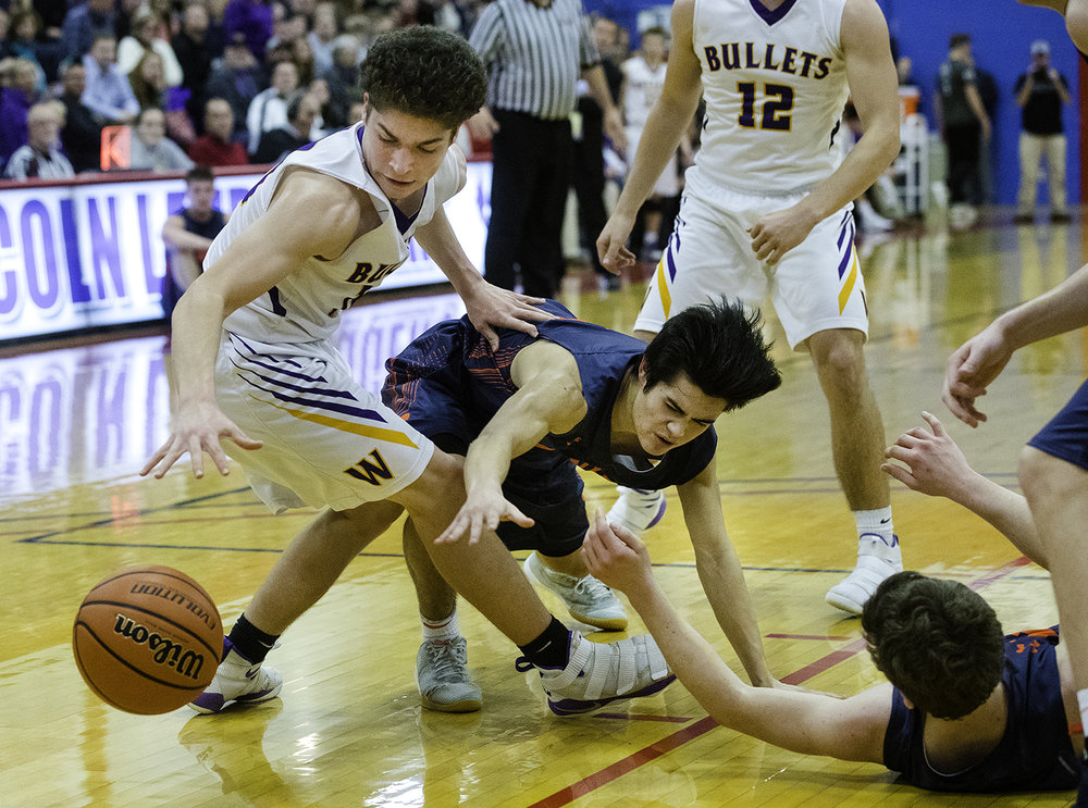 Williamsville's Griffin Keebler and New Berlin's Christian Knox lunge for a loose ball during the championship game of the Sangamon County Tournament Friday at Lincoln Land Community College, Jan. 12, 2018. [Ted Schurter/The State Journal-Register]