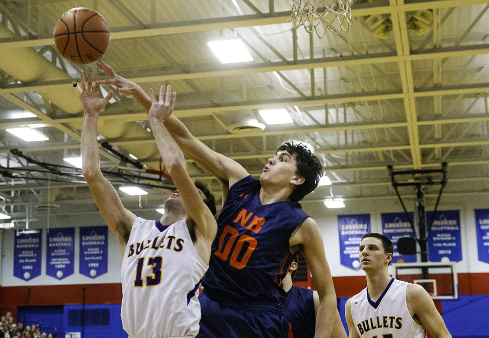 New Berlin's Max Day blocks Williamsville's Joseph Mitchell during the championship game of the Sangamon County Tournament Friday at Lincoln Land Community College, Jan. 12, 2018. [Ted Schurter/The State Journal-Register]