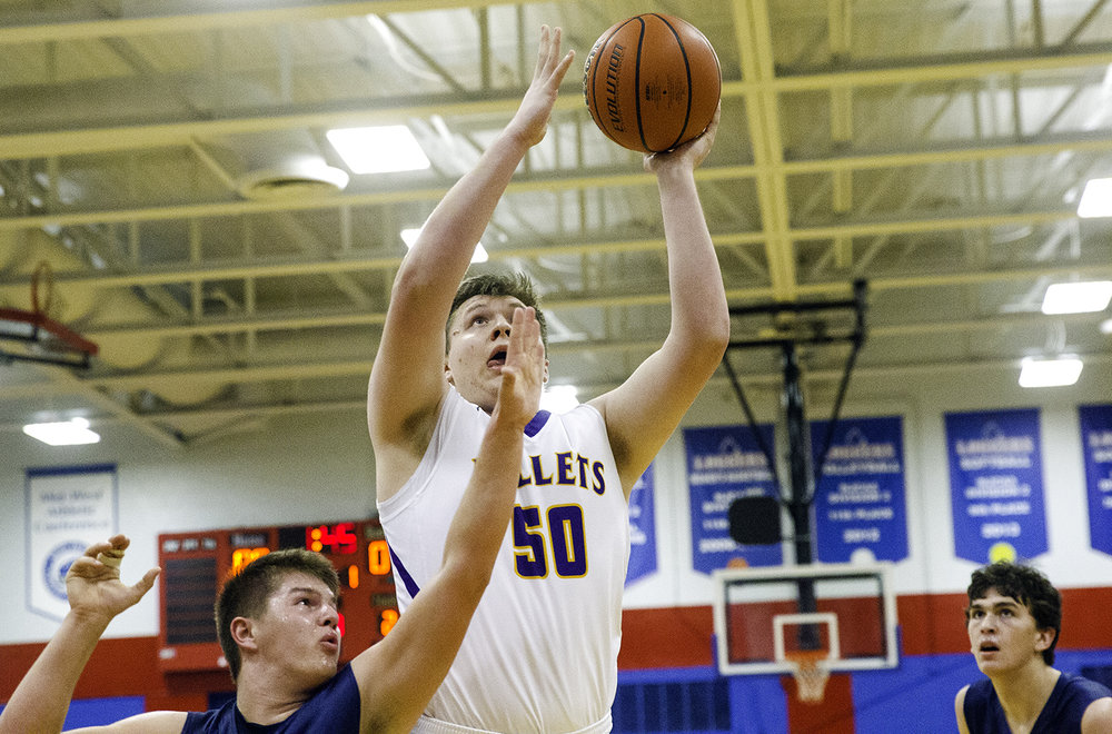 Williamsville's Hayden Moore puts up two in front of a pair of New Berlin defenders during the championship game of the Sangamon County Tournament Friday at Lincoln Land Community College, Jan. 12, 2018. [Ted Schurter/The State Journal-Register]