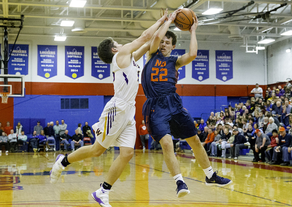 New Berlin's Connor Allen grabs a loose ball in front of Williamsville's Griffin Keebler during the championship game of the Sangamon County Tournament Friday at Lincoln Land Community College, Jan. 12, 2018. [Ted Schurter/The State Journal-Register]