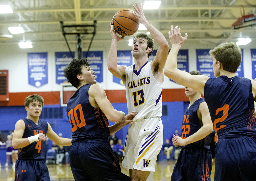 Williamsville's Joseph Mitchell gets a shot off between a pack of New Berlin defenders during the championship game of the Sangamon County Tournament Friday at Lincoln Land Community College, Jan. 12, 2018. [Ted Schurter/The State Journal-Register]
