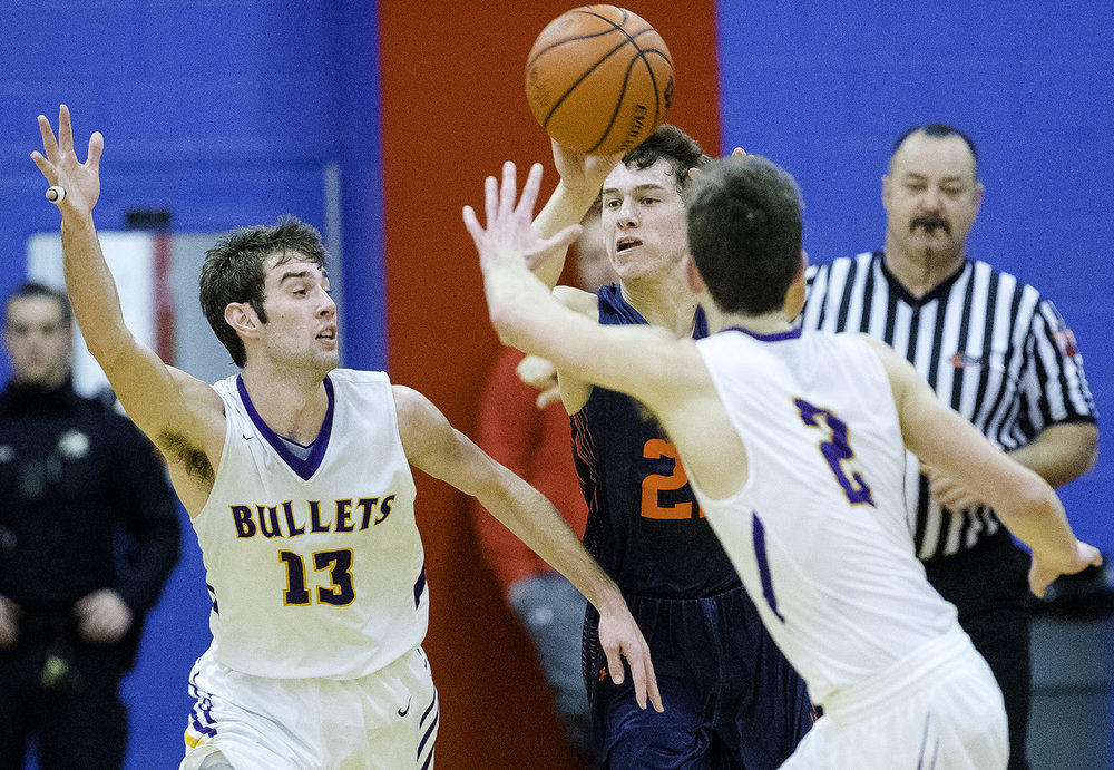 New Berlin's Connor Allen pushes the ball upcourt under pressure from Williamsville's Joseph Mitchell and Casey Tuttle during the championship game of the Sangamon County Tournament Friday at Lincoln Land Community College, Jan. 12, 2018. [Ted Schurter/The State Journal-Register]