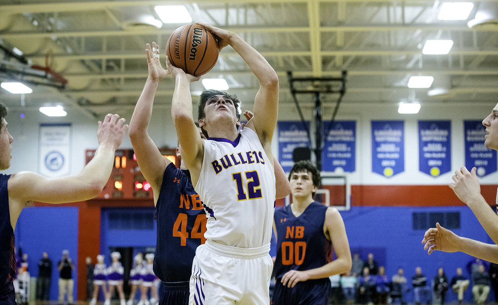 Williamsville's Keegan McGann fights to the hoop against New Berlin during the championship game of the Sangamon County Tournament Friday at Lincoln Land Community College, Jan. 12, 2018. [Ted Schurter/The State Journal-Register]
