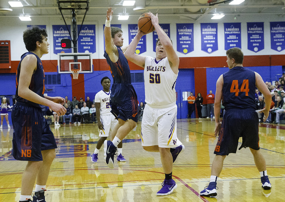 New Berlin's Carson Reese pressures Williamsville's Hayden Moore as he gets a shot off in the lane during the championship game of the Sangamon County Tournament Friday at Lincoln Land Community College, Jan. 12, 2018. [Ted Schurter/The State Journal-Register]