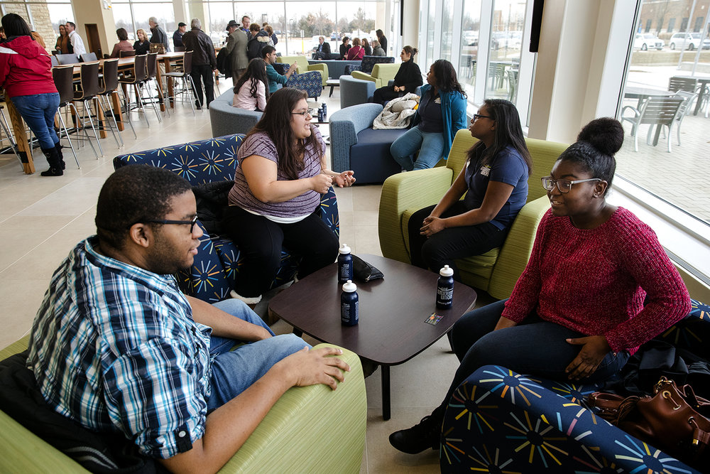 Will Newton, left and Tyshianna Bankhead visit in the lobby of the new $21.75 million Student Union Sunday, Jan. 14, 2018. [Ted Schurter/The State Journal-Register]