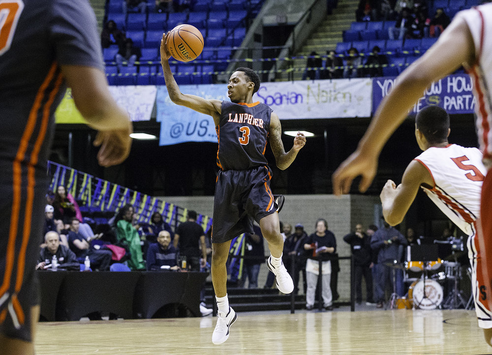 Lanphier's Devione Rayford leaps to grab an errant pass against Springfield during the Boys City Tournament at the Bank of Springfield Center Thursday, Jan. 18, 2018. [Ted Schurter/The State Journal-Register]