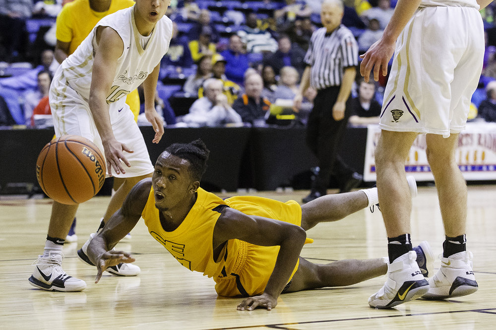 Southeast's Anthony Fairlee hits the ground as he pursues a loose ball against Sacred Heart-Griffin during the Boys City Tournament at the Bank of Springfield Center Thursday, Jan. 18, 2018. [Ted Schurter/The State Journal-Register]