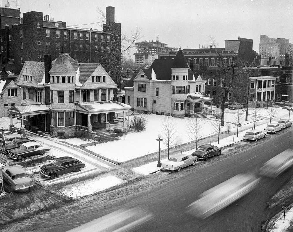 Overall view (rooftop aerial), 500 block S. Fifth Street, facing south east, Towne House apartment tower under construction in background, homes to be razed for parking lots, Jan. 25, 1957.