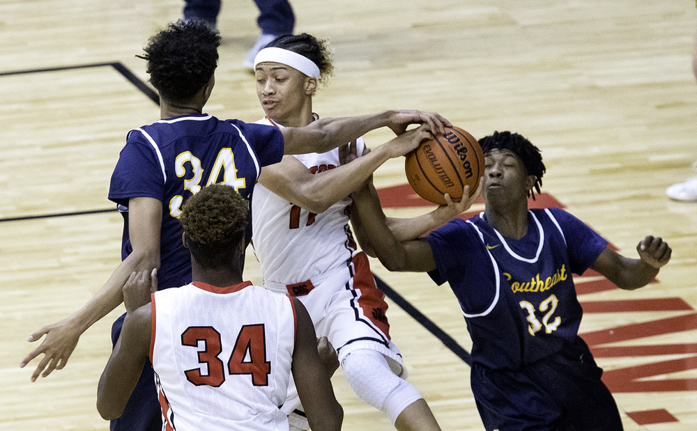 Southeast's Michael Tyler, left, and Stephens Sims pressure Springfield's Zaire Harris during the Boys City Tournament at the Bank of Springfield Center Friday, Jan. 19, 2018. [Ted Schurter/The State Journal-Register]