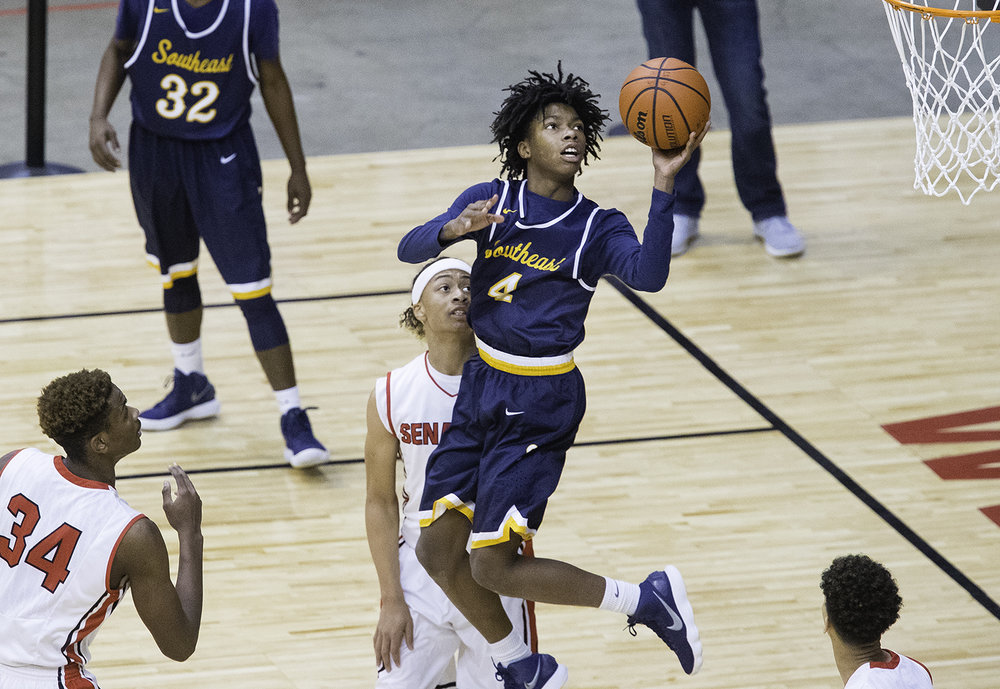 Southeast's Terrion Murdix spins and throws slips in a shot against Springfield during the Boys City Tournament at the Bank of Springfield Center Friday, Jan. 19, 2018. [Ted Schurter/The State Journal-Register]