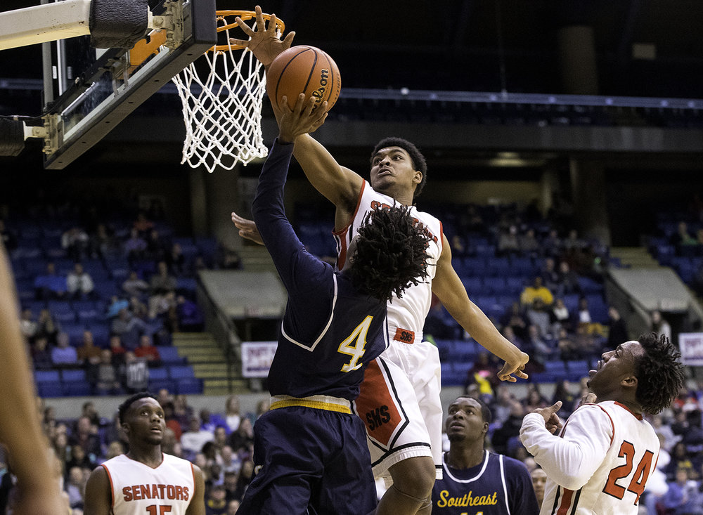Springfield's Josh Washington blocks a shot by Southeast's Terrion Murdix during the Boys City Tournament at the Bank of Springfield Center Friday, Jan. 19, 2018. [Ted Schurter/The State Journal-Register]