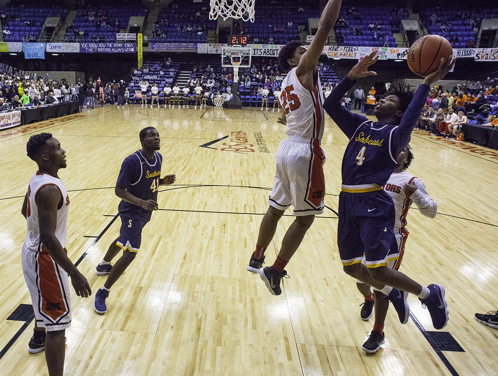 Southeast's Terrion Murdix drives past Springfield's Josh Washington on his way to the hoop during the Boys City Tournament at the Bank of Springfield Center Friday, Jan. 19, 2018. [Ted Schurter/The State Journal-Register]