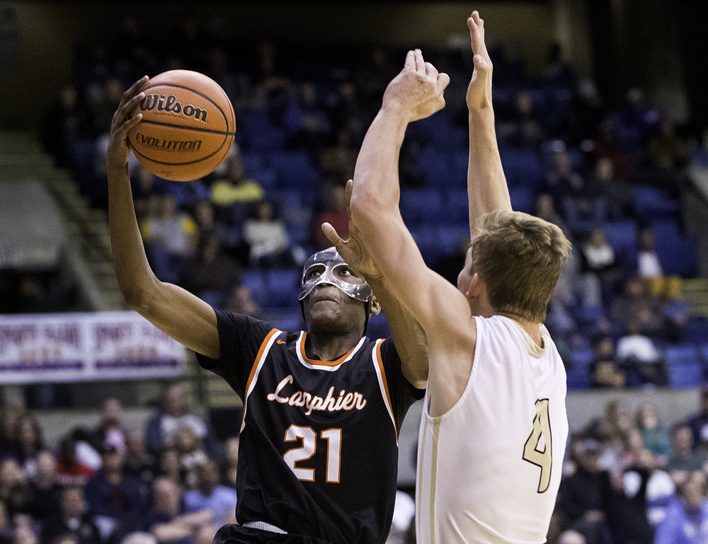 Lanphier's James Jones drives past Sacred Heart-Griffin's Charlie Hamilton during the Boys City Tournament at the Bank of Springfield Center Friday, Jan. 19, 2018. [Ted Schurter/The State Journal-Register]