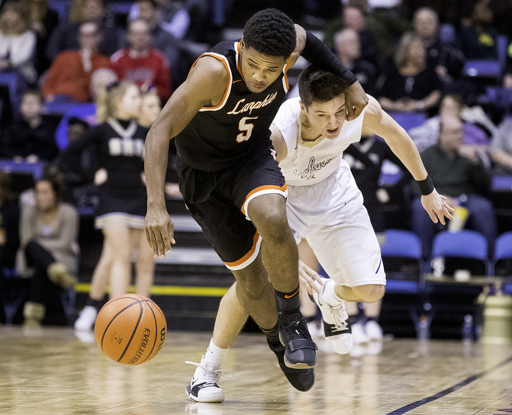 Lanphier's Stanley Morgan  beats Sacred Heart-Griffin's Evan Warrington to a loose ball during the Boys City Tournament at the Bank of Springfield Center Friday, Jan. 19, 2018. [Ted Schurter/The State Journal-Register]