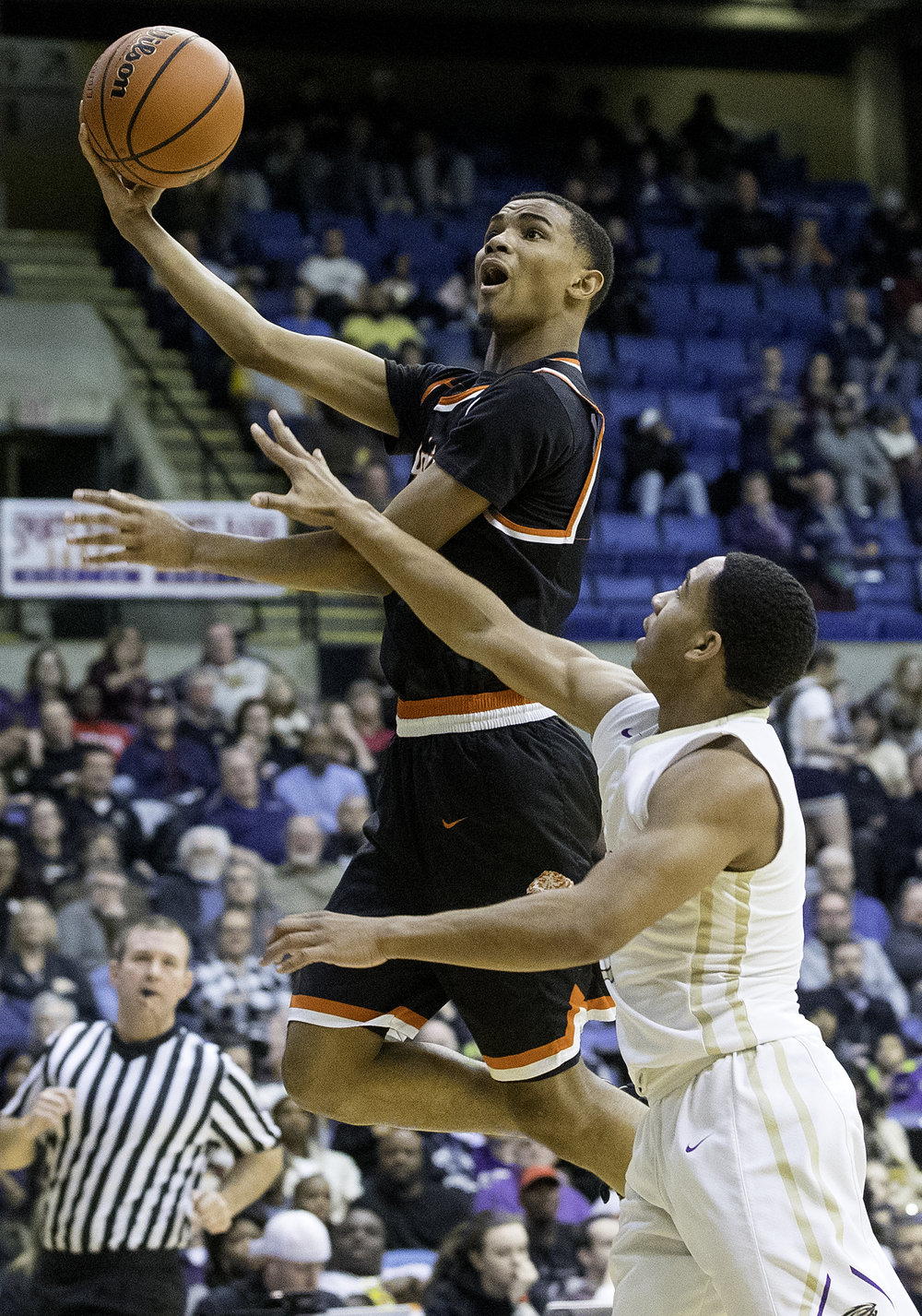 Lanphier's Cardell McGee puts in a shot in front of Sacred Heart-Griffin's Spencer Redd during the Boys City Tournament at the Bank of Springfield Center Friday, Jan. 19, 2018. [Ted Schurter/The State Journal-Register]