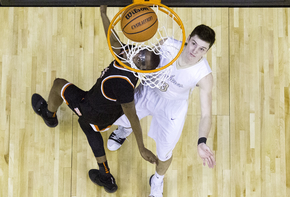 Lanphier's James Jones eyes his shot under the hoop during the Boys City Tournament at the Bank of Springfield Center Friday, Jan. 19, 2018. [Ted Schurter/The State Journal-Register]
