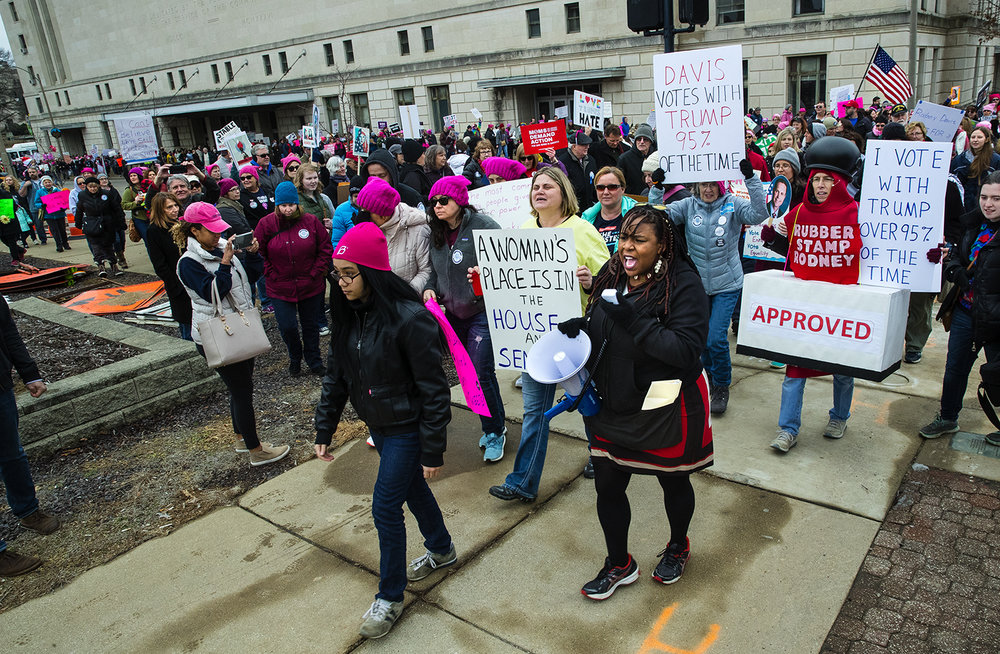 Shatriya Smith of Springfield leads marchers onto Adams Street toward the Old State Capitol plaza during the Action Illinois Springfield 'Women's March to the Polls' rally and march in Springfield, Ill., Saturday, Jan. 20, 2018. [Ted Schurter/The State Journal-Register]