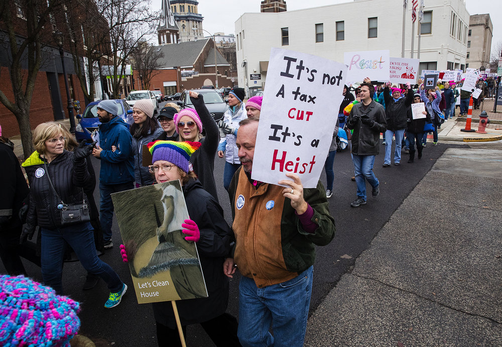 Marchers head down Adams Street toward the Old State Capitol plaza during the Action Illinois Springfield 'Women's March to the Polls' rally and march in Springfield, Ill., Saturday, Jan. 20, 2018. [Ted Schurter/The State Journal-Register]