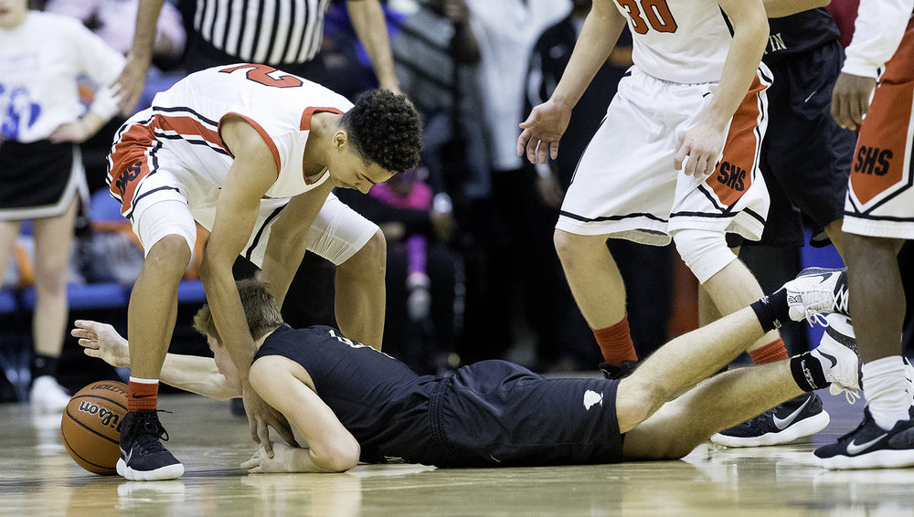 Sacred Heart-Griffin's Charlie Hamilton plows under Springfield's Bennie Slater as they race for a loose ball during the Boys City Tournament at the Bank of Springfield Center Saturday, Jan. 20, 2018. [Ted Schurter/The State Journal-Register]