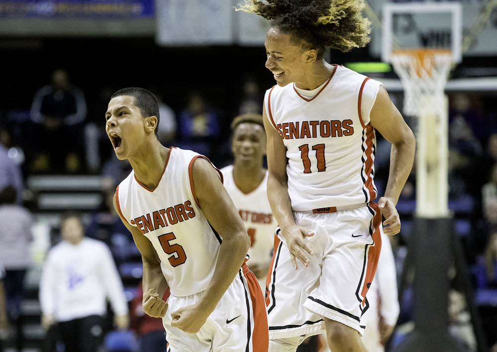 Springfield's Shane Miller lets out a roar after a score against Sacred Heart-Griffin during the Boys City Tournament at the Bank of Springfield Center Saturday, Jan. 20, 2018. [Ted Schurter/The State Journal-Register]
