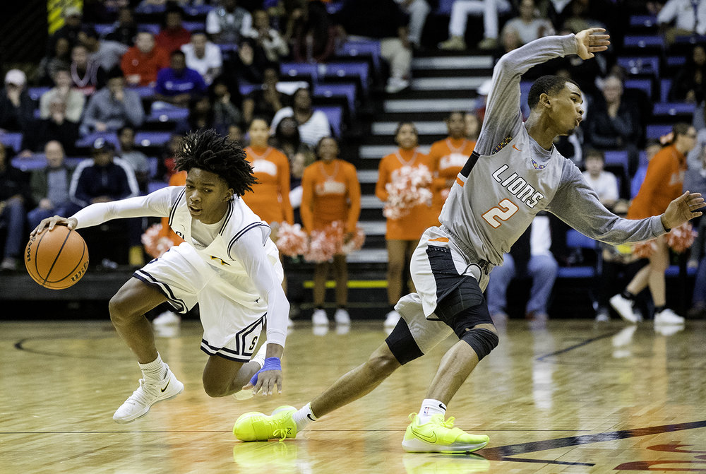 Southeast's Terrion Murdix and Lanphier's Cardell McGee fall to the floor after McGee picked up his fourth foul during the Boys City Tournament at the Bank of Springfield Center Saturday, Jan. 20, 2018. [Ted Schurter/The State Journal-Register]