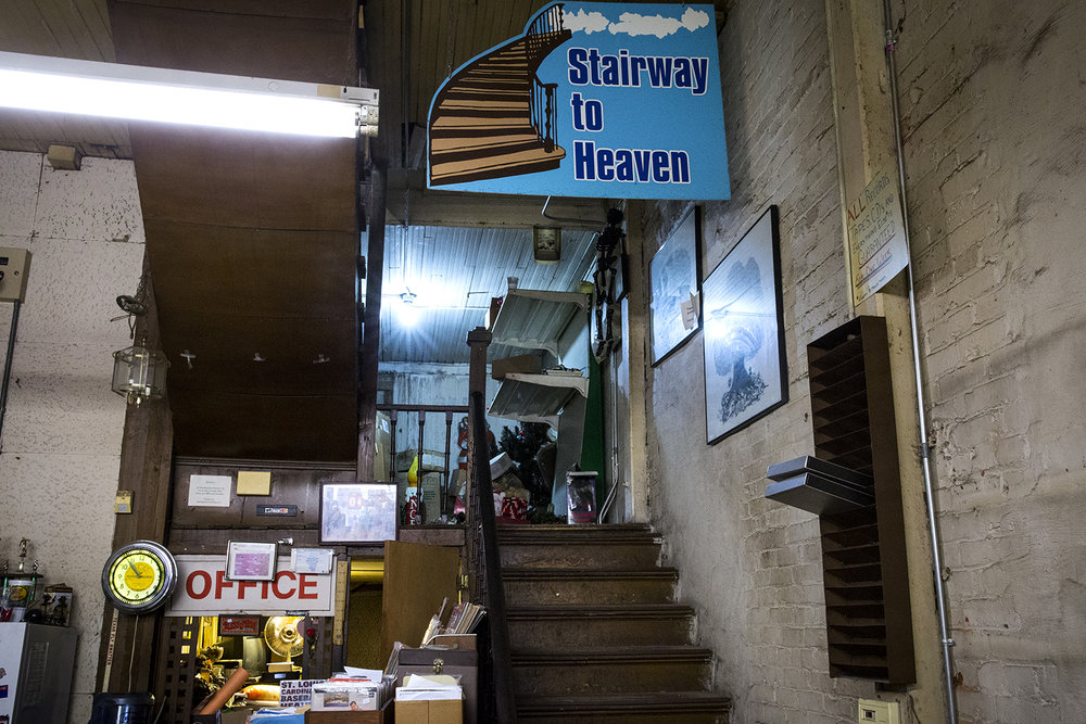 A sign over the staircase leads customers to the record section on the second floor of Recycled Records. [Rich Saal/The State Journal-Register]