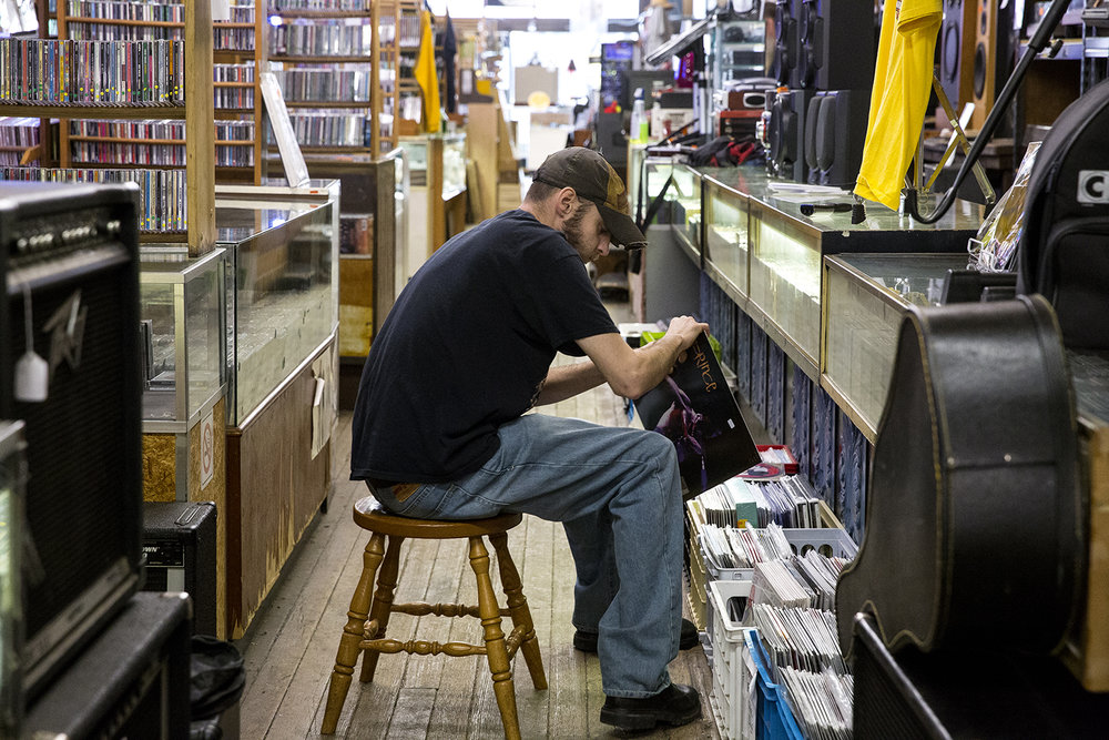 Jon O'Neal sorts records Monday at Recycled Records. [Rich Saal/The State Journal-Register]